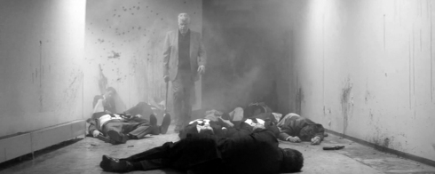 Fig 23 - Ron Perlman in a pile of dead bodies